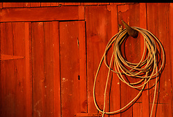 Red building wall with a hanging lasso