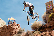 Andrew Taylor drops a cliff at the 2010 Red Bull Rampage Freeride Competition in Virgin, Utah