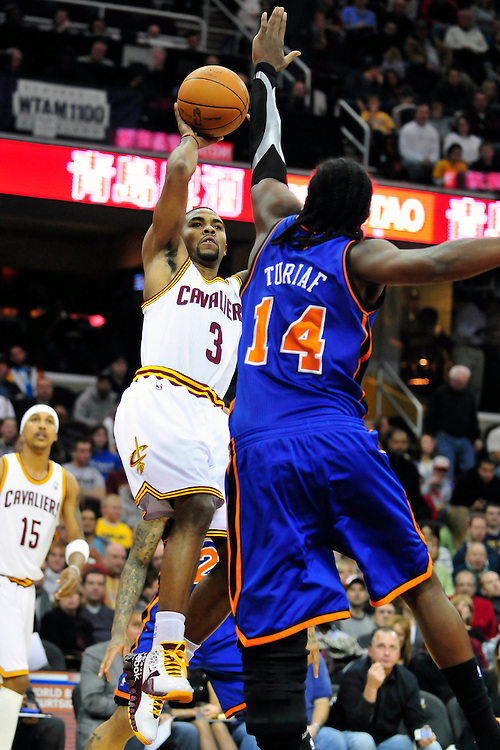 Dec. 18, 2010; Cleveland, OH, USA; Cleveland Cavaliers point guard Ramon Sessions (3) shoots over New York Knicks center Ronny Turiaf (14) during the second quarter at Quicken Loans Arena. The Cavaliers beat the Knicks 109-102 in overtime. Mandatory Credit: Jason Miller-US PRESSWIRE