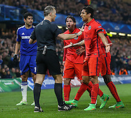Paris Saint-Germain players protest to Referee, Mr Bjorn Kuipers, at the booking received by David Luiz of Paris Saint-Germain (not pictured) during the UEFA Champions League match at Stamford Bridge, London<br /> Picture by David Horn/Focus Images Ltd +44 7545 970036<br /> 11/03/2015