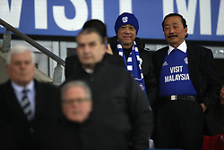 Cardiff City owner Vincent Tan (right) and former chairman Peter Ridsdale (far left) during the Sky Bet Championship match at The Den, London.