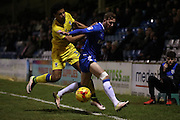Gillingham FC midfielder Scott Wagstaff (7) and AFC Wimbledon striker Lyle Taylor (33) during the EFL Sky Bet League 1 match between Gillingham and AFC Wimbledon at the MEMS Priestfield Stadium, Gillingham, England on 21 February 2017.