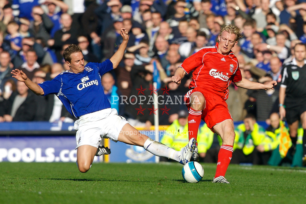 Liverpool, England - Saturday, October 20, 2007: Liverpool's Dirk Kuyt is tackled late by Everton's Phil Jagielka during the 206th Merseyside Derby match at Goodison Park. (Photo by David Rawcliffe/Propaganda)