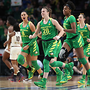 March 31, 2019; Portland, OR, USA;  Oregon Ducks guard Sabrina Ionescu (20) and her teammates are all smiles as they head to the bench after a play Mississippi State Bulldogs in the second half of Elite Eight of the NCAA Women's Tournament at Moda Center.<br /> Photo by Jaime Valdez