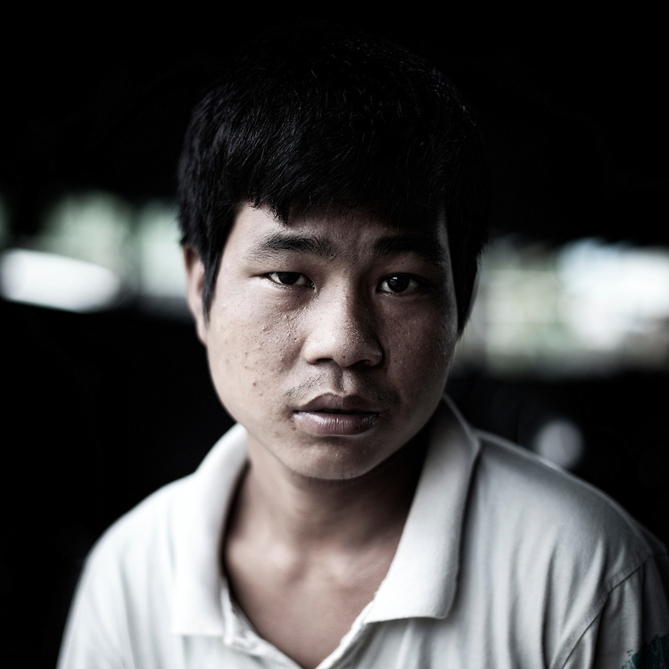 A Burmese Army child soldier's Min Min, from Myaung Lay Pin village and 19 years old, pose for a portrait in Kachin's jail of Woi Chyai for prisioners of war in Laiza village close to the China border, Myanmar on July 15, 2012. Was captured 2 months ago and he tell doesn't know where was captured.