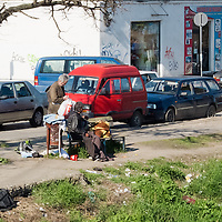 TIMISOARA, ROMANIA - APRIL 21:  Two poor try to collect whatever they can find near a daily market on April 21, 2013 in Timisoara, Romania.  Romania has abandoned a target deadline of 2015 to switch to the single European currency and will now submit to the European Commission a programme on progress towards the adoption of the Euro, which for the first time will not have a target date. (Photo by Marco Secchi/Getty Images)