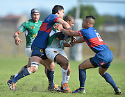 GEORGE, SOUTH AFRICA - SEPTEMBER 24: Leegan Moos of RSK Evergreens is tackled by Duncan Delport of Pirates and Zunaid Kock of Pirates during the Gold Cup 2016 match between RSK Evergreens and Pirates at Pacaltsdorp Sports Ground on September 24, 2016 in George, South Africa. (Photo by Roger Sedres/Gallo Images)