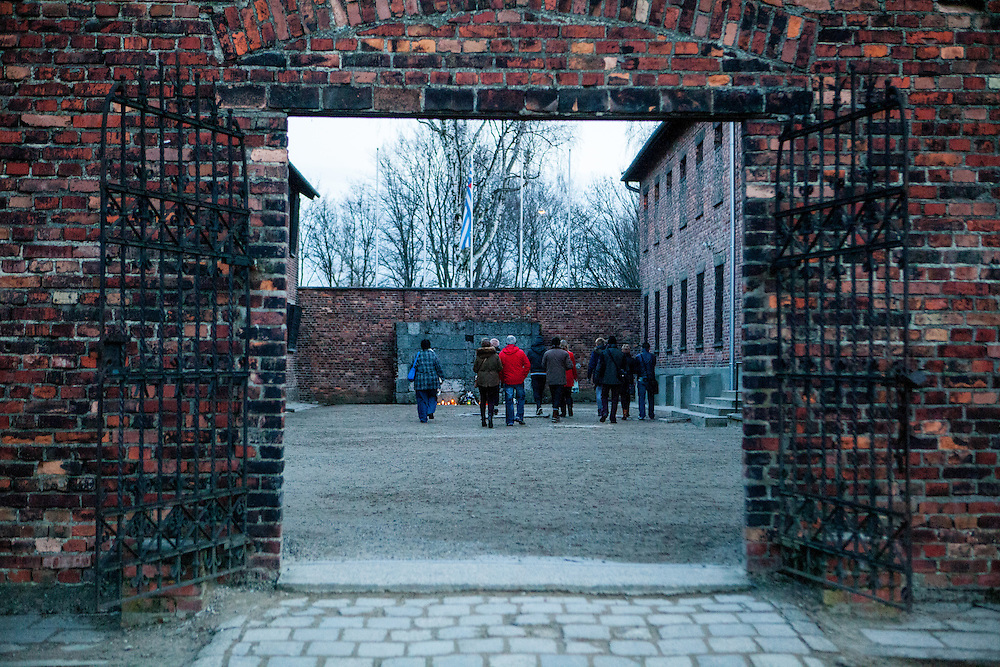 Visitors at the Death Wall (BlackWall) where shooting executions took place at the Auschwitz Nazi concentration camp. It is estimated that between 1.1 and 1.5 million Jews, Poles, Roma and others were killed in Auschwitz during the Holocaust in between 1940-1945.