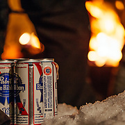 Beers in the snow in front of the fire pit during Hostel X team practice.