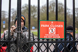 © Licensed to London News Pictures. 09/02/2020. London, UK. Security pad locks Richmond Gate in Richmond Park as it closes its gates to the public. Storm Ciara hits London and the South East as Richmond Park and 7 other Royal Parks close their gates this morning as weather experts predict stormy weather with very high winds and heavy rain for Sunday. Photo credit: Alex Lentati/LNP