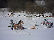 Humorous Photo of Toy Horses in Winter