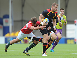 Clemens Von Grumbkov of Germany is challenged by Francisco Sousa of Portugal  - Photo mandatory by-line: Dougie Allward/JMP - Mobile: 07966 386802 - 11/07/2015 - SPORT - Rugby - Exeter - Sandy Park - European Grand Prix 7s