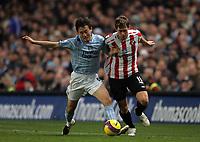 Photo: Paul Thomas/Sportsbeat Images.<br /> Manchester City v Sunderland. The FA Barclays Premiership. 05/11/2007.<br /> <br /> Jihai Sun (L) tackles Sunderland's Daryl Murphy.