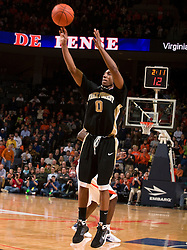 Wake Forest guard Jeff Teague (0) shoots a three point jump shot against UVA.  The Virginia Cavaliers fell to the #13 ranked Wake Forest Demon Deacons 70-60 at the John Paul Jones Arena on the Grounds of the University of Virginia in Charlottesville, VA on February 28, 2009.