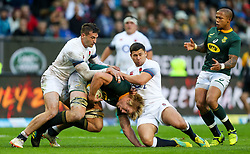 Jonny May and Ben Youngs of England tackling Pieter-Steph du Toit of South Africa - Mandatory by-line: Steve Haag/JMP - 23/06/2018 - RUGBY - DHL Newlands Stadium - Cape Town, South Africa - South Africa v England 3rd Test Match, South Africa Tour