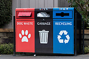 Garbage, recycling and dog waste receptacles in Langley, British Columbia, Canada.