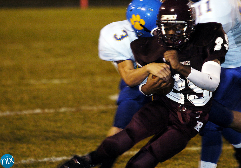 Robinson's Jason Hampton (25) is tackled by Mount Pleasant's NIck Albertson (3) Friday night.