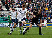 Jordan Hugill of Preston North End  and George Saville of Millwall during the EFL Sky Bet Championship match between Preston North End and Millwall at Deepdale, Preston, England on 23 September 2017. Photo by Paul Thompson.