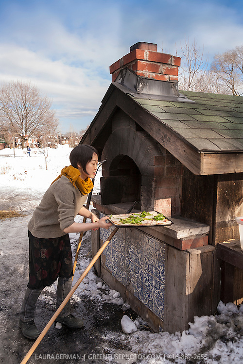 Baking pizza in the outdoor brick bread oven at Dufferin Grove park in early March with snow on the ground.