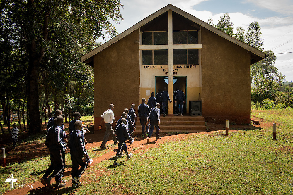 Young men of the Othoro ELCK (Evangelical Lutheran Church in Kenya) Project 24 boarding facility walk to worship at the Othoro Lutheran congregation on Sunday, Oct. 18, 2015, in Kisumu, Kenya. LCMS Communications/Erik M. Lunsford