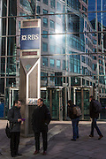 British bankers stand outside the Royal Bank of Scotland, RBS, Head Office in Bishopsgate, London, United Kingdom.