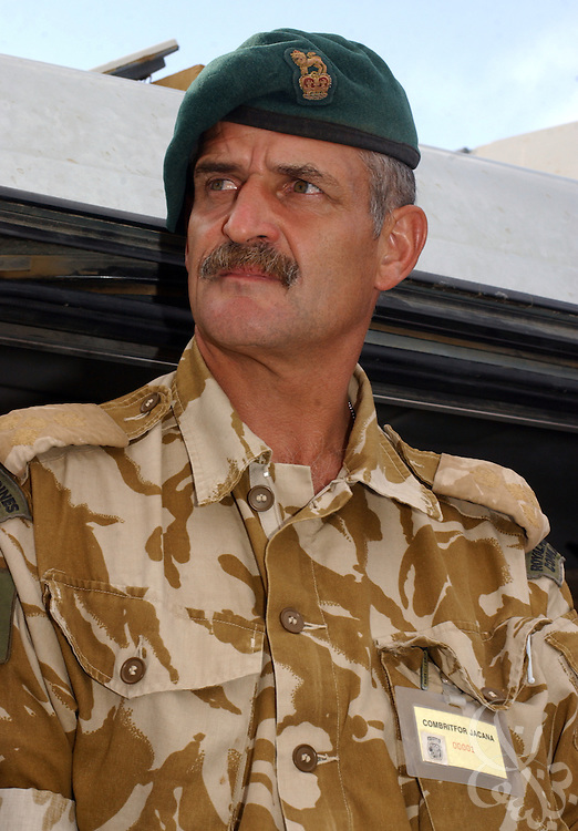 Brigadier Roger Lane, commander of British Royal Marines 3 Commando Brigade in Afghanistan speaks with members of the press May 29, 2002 at Bagram airbase in Bagram, Afghanistan. Brigadier Lane has been replaced as commander of the unit after questions arose from critics regarding his leadership of the Royal marine force in Afghanistan. Lane will be replaced by Brigadier Jim Dutton upon the unit's return to the UK.