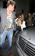 10.MAR.2011 LONDON<br /> <br /> KATIE PRICE AND NEW MAN LEANDRO PENNA LEAVING KATIE BEST FRIENDS PHIL TURNER AND GARY COCKERILL'S HOUSE BEFORE HEADING TO HAKKASAN RESTAURANT IN MAYFAIR WHERE THEY STAYED TILL 10.30PM AND HEADED ONTO GEM BAR IN SOHO WHERE THEY PARTIED TILL 1.30AM BEFORE CALLING IT A NIGHT AND HEADING HOME.<br /> <br /> BYLINE: EDBIMAGEARCHIVE.COM<br /> <br /> *THIS IMAGE IS STRICTLY FOR UK NEWSPAPERS AND MAGAZINES ONLY*<br /> *FOR WORLD WIDE SALES AND WEB USE PLEASE CONTACT EDBIMAGEARCHIVE - 0208 954 5968*