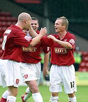 Photo: Dave Linney.<br />Walsall v Mansfield Town. Coca Cola League 2. 30/09/2006Walsall's .Dean Keates celebrates with Michael Dobson(L) & Anthony Gerrard(C) after firing Walsall ahead.