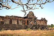 The ruins of ancient and historic Angkor era Wat Phu, built by the Khmers, stand in the afternoon sun in Champasak, Laos.  Wat Phu was granted UNESCO World Heritage status in 2001.