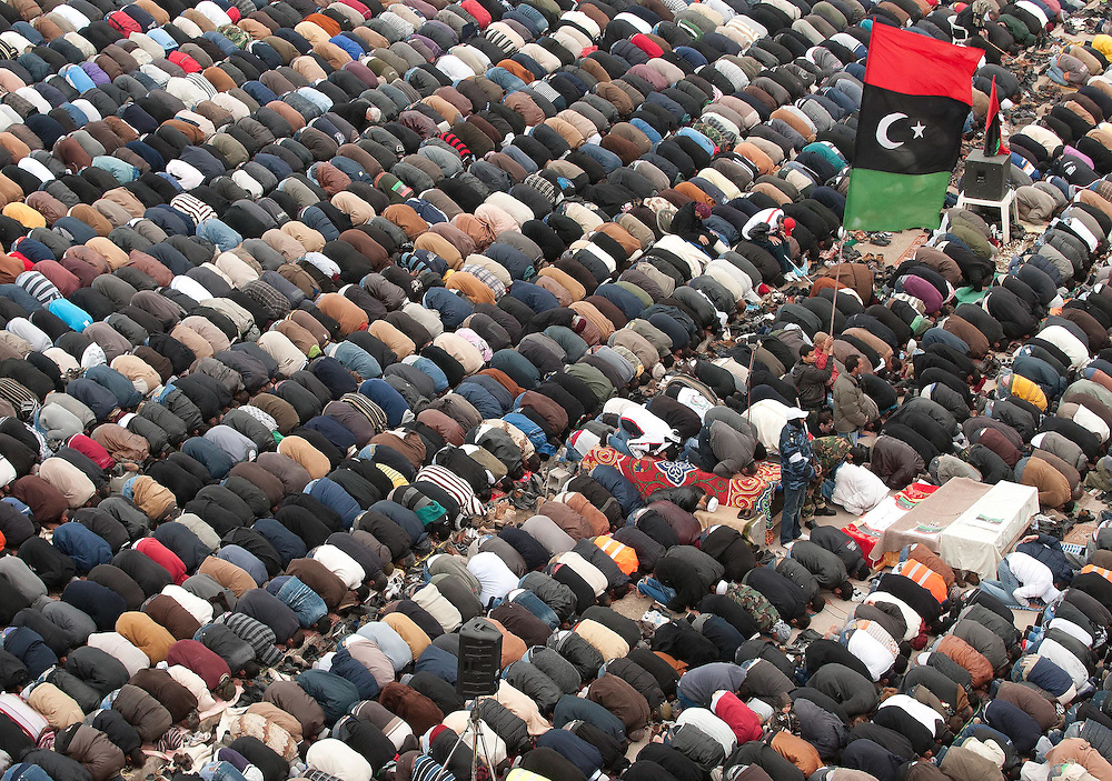 People pray at midday Friday prayers at the main square in Benghazi, Libya.