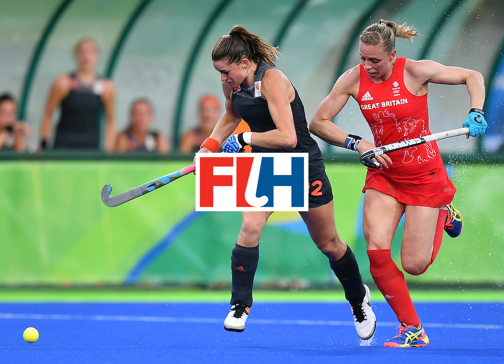 Netherlands' Lidewij Welten (L) vies with Britain's Kate Richardson-Walsh during the women's Gold medal hockey Netherlands vs Britain match of the Rio 2016 Olympics Games at the Olympic Hockey Centre in Rio de Janeiro on August 19, 2016. / AFP / MANAN VATSYAYANA        (Photo credit should read MANAN VATSYAYANA/AFP/Getty Images)