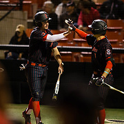 16 February 2018: San Diego State baseball opened up the season against UCSB at Tony Gwynn Stadium. San Diego State third baseman Casey Schmitt (8) congratulates Jordan Verdon after scoring on a single by teammate Chad Bible (not pictured). The Aztecs beat the Gauchos 9-1. <br /> More game action at sdsuaztecphotos.com