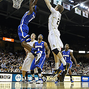 Memphis guard Will Barton (5) grabs a rebound from Central Florida forward P.J. Gaynor (21) during a Conference USA NCAA basketball game between the Memphis Tigers and the Central Florida Knights at the UCF Arena on February 9, 2011 in Orlando, Florida. Memphis won the game 63-62. (AP Photo: Alex Menendez)