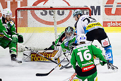 Gregor Baumgartner (EHC Liwest Linz, #79) vs Matija Pintaric (HDD Tilia Olimpija, #69) during ice-hockey match between HDD Tilia Olimpija and EHC Liwest Black Wings Linz at second match in Semifinal  of EBEL league, on March 8, 2012 at Hala Tivoli, Ljubljana, Slovenia. (Photo By Matic Klansek Velej / Sportida)