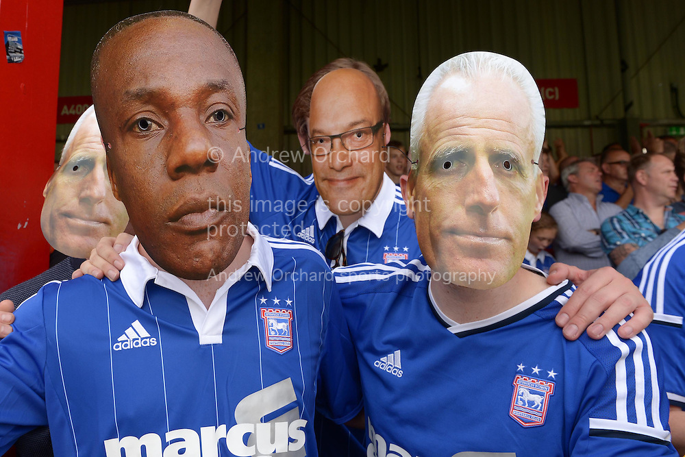 some Ipswich Town fans wear carboard face masks of Terry Connor, the Ipswich Town assistant manager (l), Gregg Wallace, the Masterchef host &copy; and Mick McCarthy, the Ipswich Town manager (r) before k/o. Skybet football league Championship match, Brentford v Ipswich Town at Griffin Park in London on Saturday 8th August 2015.<br /> pic by John Patrick Fletcher, Andrew Orchard sports photography.
