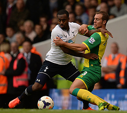 Tottenham's Danny Rose and Norwich's Steven Whittaker compete for the ball  - Photo mandatory by-line: Mitchell Gunn/JMP - Tel: Mobile: 07966 386802 14/09/2013 - SPORT - FOOTBALL -  White Hart Lane - London - Tottenham Hotspur v Norwich - Barclays Premier League