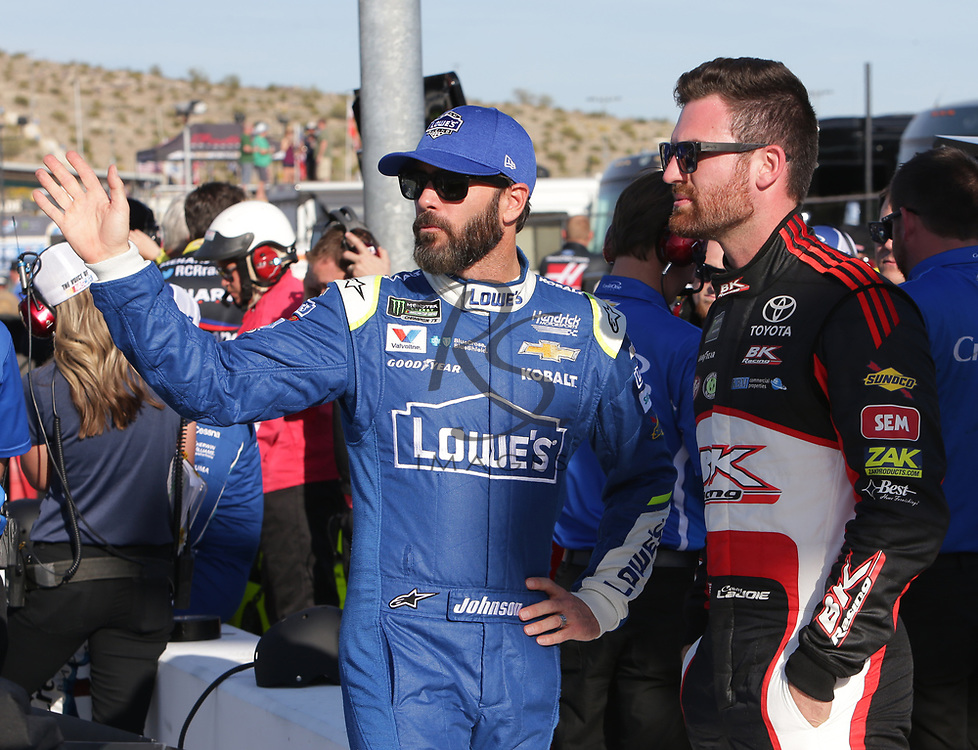 Jimmie Johnson and Corey LaJoie before qualifying for Sunday's NASCAR Cup Series auto race on Friday, March 17, 2017, in Avondale, Ariz.  (AP Photo/Rick Scuteri)