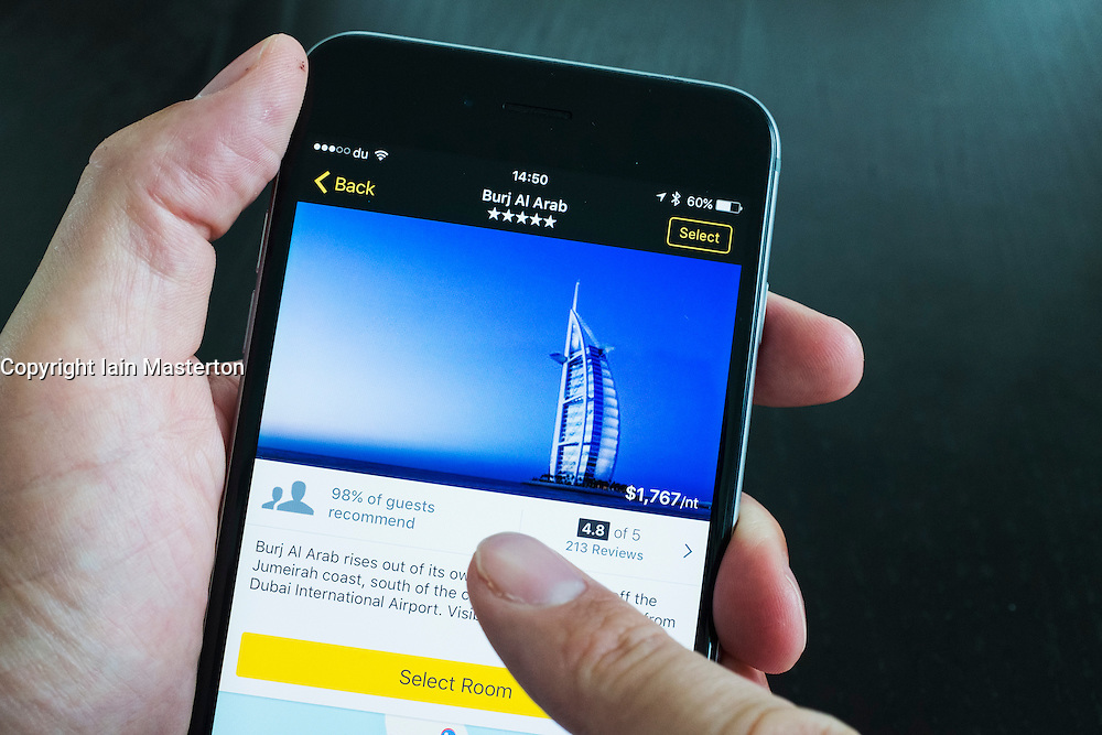 Burj Al Arab luxury hotel on Expedia travel website app on iPhone 6 Plus smart phone