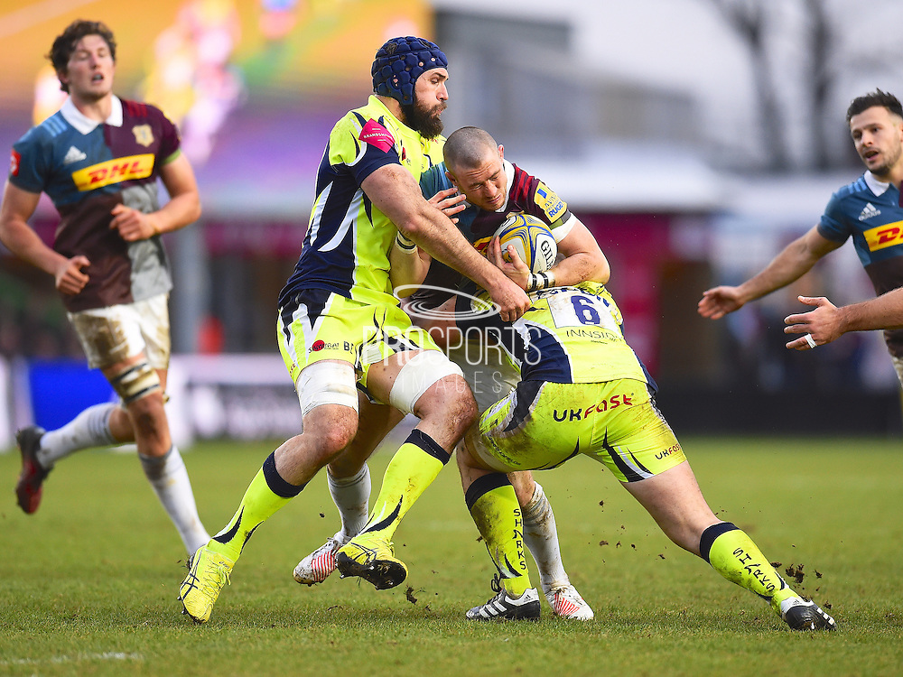 Helicons player Mike Brown is tackled hard during the first half during the Aviva Premiership match between Harlequins and Sale Sharks at Twickenham Stoop, Twickenham, United Kingdom on 7 January 2017. Photo by Ian  Muir.during the Aviva Premiership match between Harlequins and Sale Sharks at Twickenham Stoop, Twickenham, United Kingdom on 7 January 2017. Photo by Ian  Muir.