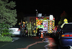Auckland-Person suffers burns in roof fire, Massey