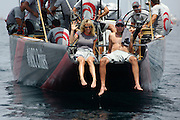 Alinghi head Ernesto Bertarelli and wife Kristy sit in the sugar scoop of SUI75 awaiting the delayed start of race 1. Louis Vuitton Act 5. Valencia, Spain. 24/6/2005