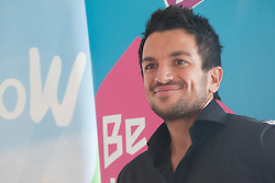© Licensed to London News Pictures. 26/01/2012. London, England. Today, 26 January, popstar and children's author Peter Andre presented twenty London school children with awards at City Hall for winning stories they have written about where they live, part of the Mayor of London's drive to improve literacy. The competition was also part of the Big WoW (Walk once a Week). Photo credit: Bettina Strenske/LNP