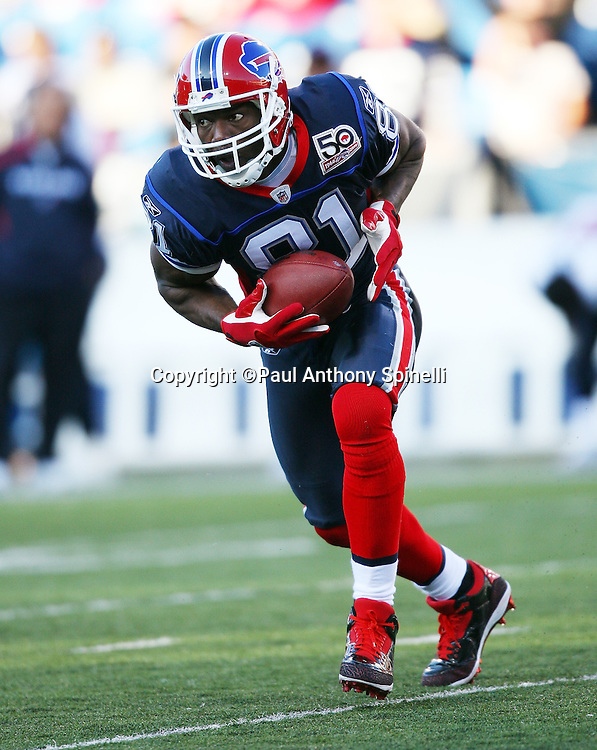 Buffalo Bills wide receiver Terrell Owens (81) runs with the ball after catching a fourth quarter pass during the NFL football game against the Houston Texans, November 1, 2009 in Orchard Park, New York. The Texans won the game 31-10. (©Paul Anthony Spinelli)