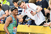 Omar McLeod (JAM) posses with a fan after winning the men's 110m hurdles in a time of 13.21 during the Birmingham Grand Prix, Sunday, Aug 18, 2019, in Birmingham, United Kingdom. (Steve Flynn/Image of Sport via AP)