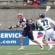 Brent Adams #28 of the Boston Cannons keeps the ball away from Stephen Peyser #77 of the Chesapeake Bayhawks during the game at Harvard Stadium on April 27, 2014 in Boston, Massachusetts. (Photo by Elan Kawesch)