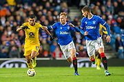 Scott Arfield (#37) and Borna Barisic (#31) of Rangers FC look to track the run of Jesus Corona (#17) of FC Porto during the Group G Europa League match between Rangers FC and FC Porto at Ibrox Stadium, Glasgow, Scotland on 7 November 2019.