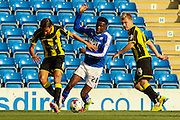 Chesterfield FC miffielder Gboly Ariyibi wins the ball from Burton Albion forward Abdenasser El Khayati during the Sky Bet League 1 match between Chesterfield and Burton Albion at the Proact stadium, Chesterfield, England on 26 September 2015. Photo by Aaron Lupton.
