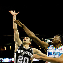 Jan 7, 2013; New Orleans, LA, USA; San Antonio Spurs shooting guard Manu Ginobili (20) shoots over New Orleans Hornets small forward Al-Farouq Aminu (0) during the second quarter of a game at the New Orleans Arena. Mandatory Credit: Derick E. Hingle-USA TODAY Sports