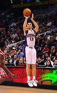 Jan. 6 2010; Phoenix, AZ, USA; Phoenix Suns guard Steve Nash (13) puts up a shot against the Houston Rockets at the US Airways Center. Phoenix Suns defeated the Houston Rockets 118-110.  Mandatory Credit: Jennifer Stewart-US PRESSWIRE