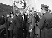 Body of Private Stephen Griffin killed in Lebanon is returned to his home soil..1980-04-19.19th April 1980.19-04-1980.04-19-80..Photographed at Arbor Hill:..An Taoiseach Charles Haughey TD in conversation with Captain Tom Rigney, Unifil, who accompanied the body of the dead soldier back from the Lebanon. Padraig Faughner TD, Minister of Defence stands betweeen them while Maire Geoghegan Quinn TD is in background.